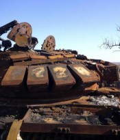 A destroyed T-72 tank is seen on a battlefield near separatist-controlled Starobesheve