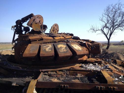 A destroyed T-72 tank is seen on a battlefield near separatist-controlled Starobesheve