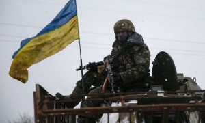 Members of the Ukrainian armed forces ride on a military vehicle near Debaltseve