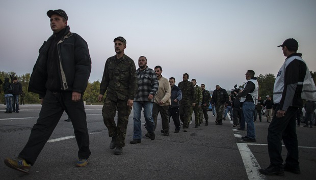 Members of the Ukrainian government forces, who are prisoners-of-war (POWs), walk along a road as they wait to be exchanged, north of Donetsk, eastern Ukraine