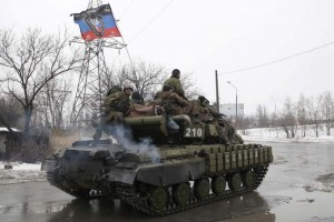 Members of the armed forces of the separatist self-proclaimed Donetsk People's Republic drive an armoured vehicle on the outskirts of Donetsk
