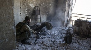 A pro-Russian separatist fires an automatic grenade launcher from his position during fighting with Ukrainian government forces near the Sergey Prokofiev International Airport in Donetsk