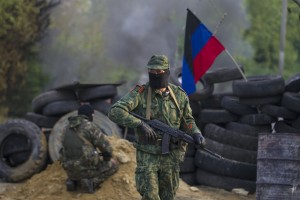 Pro-Russian separatists guard a checkpoint near the town of Slaviansk