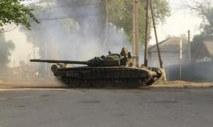 A tank drives along a street of the Russian southern town of Matveev Kurgan