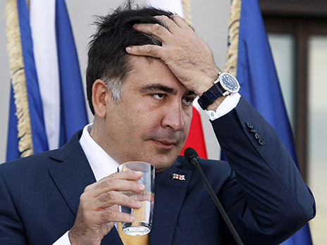 Georgia's President Saakashvili reacts during a joint news conference with NATO Secretary General Rasmussen in Tbilisi