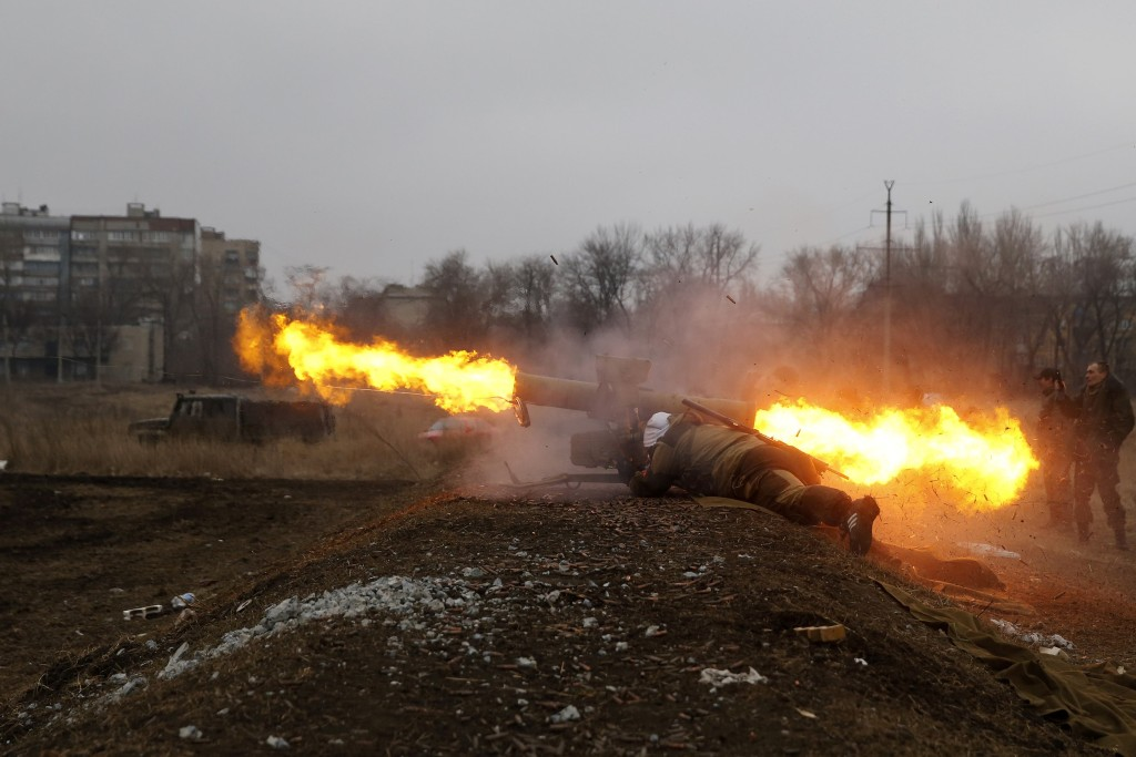 A volunteer of the separatist self-proclaimed Donetsk People's Republican guard fires a Konkurs wire-guided anti-tank missile  during shooting training in Donetsk